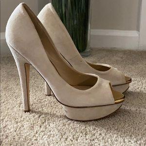 Cream colored heels by Aldo size 39